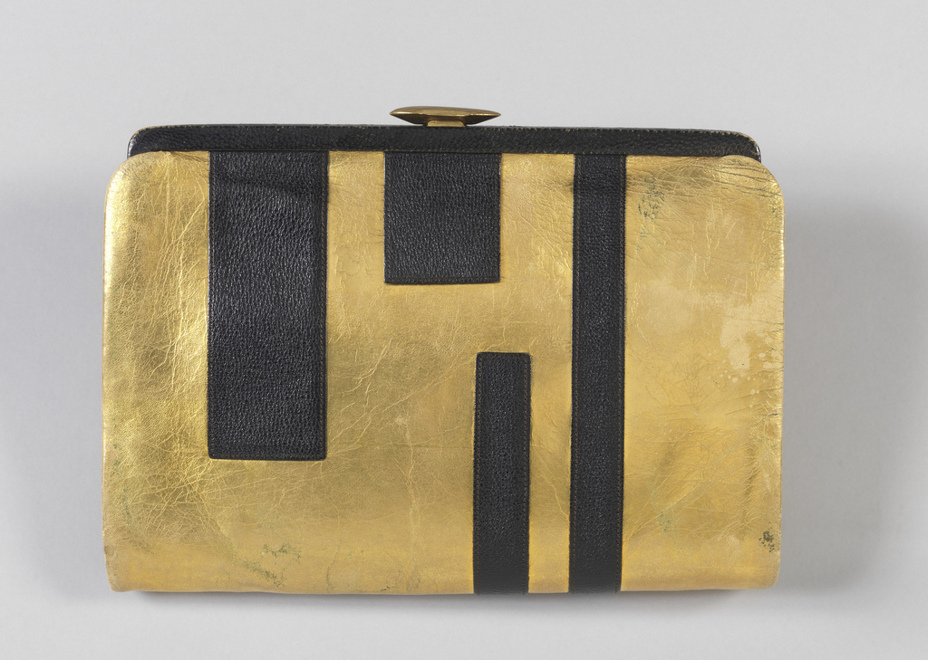 Rectangular clutch covered in gold-colored leather with black rectangles, metal clasp.