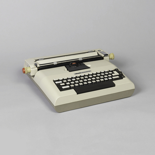 """First electric portable typewriter to use a """"golf ball"""" moveable printing element.  To keep width to a minimum, it has moveable carriage and fixed typing point; ball element pivots and types while staying in place."""