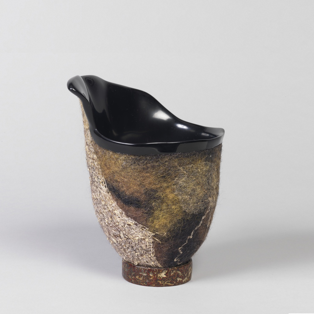 Irregular bowl form with lacquer surface to interior and top rim, the exterior with raised felt incorporated into the side and foot.