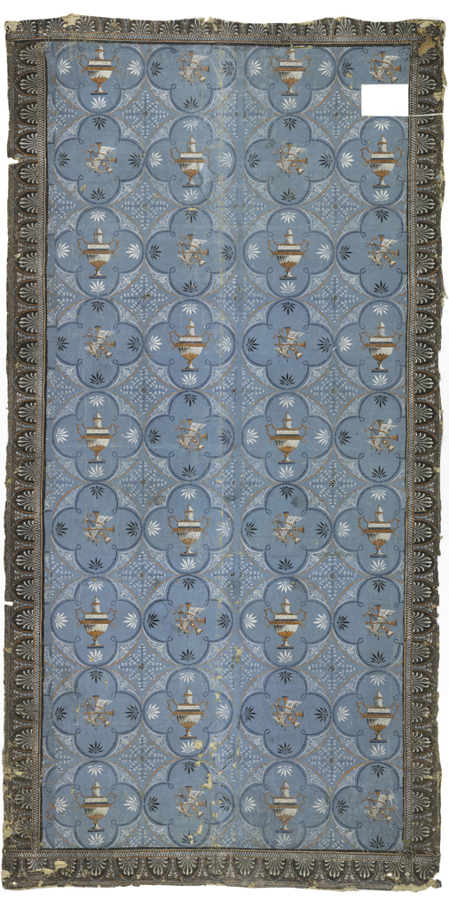 Vertical rectangular panel with applied border on four sides. The panel consists of quatrefoil medallions alternately enclosing urns and musical symbols. Between medallions are stylized bellflowers radiating around a core. Red, orange, black and white on a light blue ground. Border pattern is Grecian honeysuckle in white on brown ground with red-orange, white, and blue butterflies. Printed on sheet paper in three lengths with wide margin in center of panel.