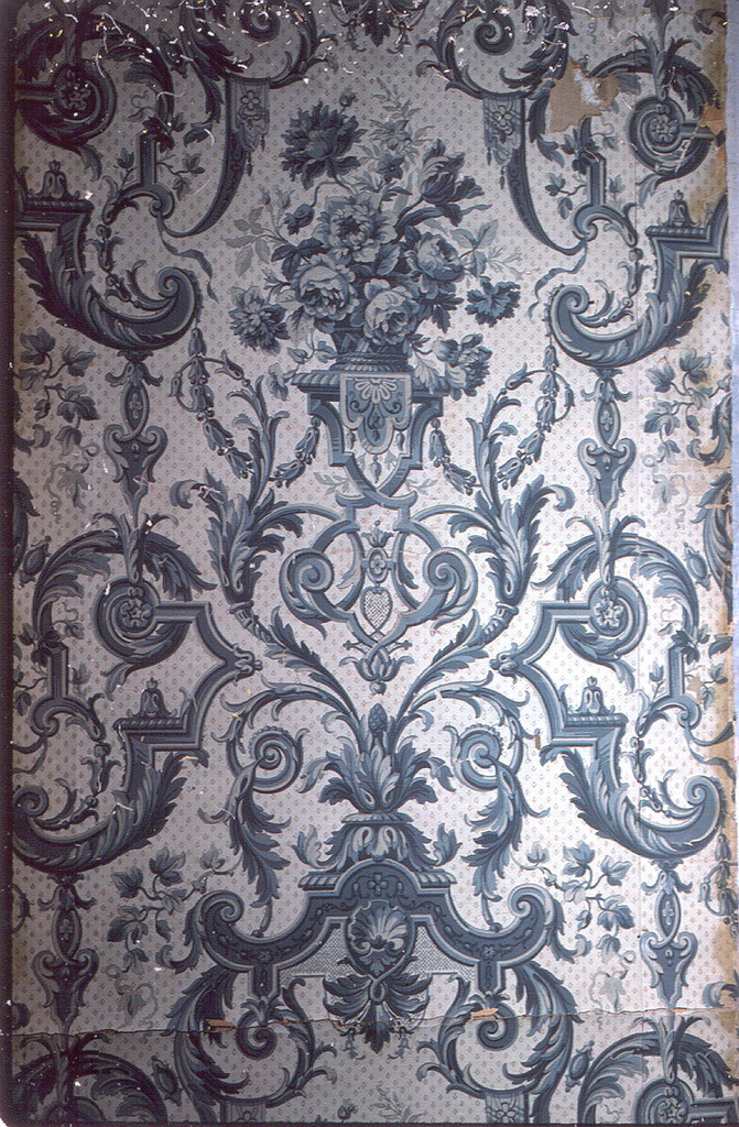 Roses and foliate forms and scrollwork, gray and blue. Pale gray ground has sprig diaper.