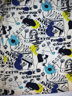 """Shirtwaist dress with long sleeves and a full skirt, made from off-white printed cotton fabric with black graphic images of clowns and acrobats, with the text """"J'ai seul la clef a cette parade sauvage."""" With patches of turquoise blue and yellow-green."""