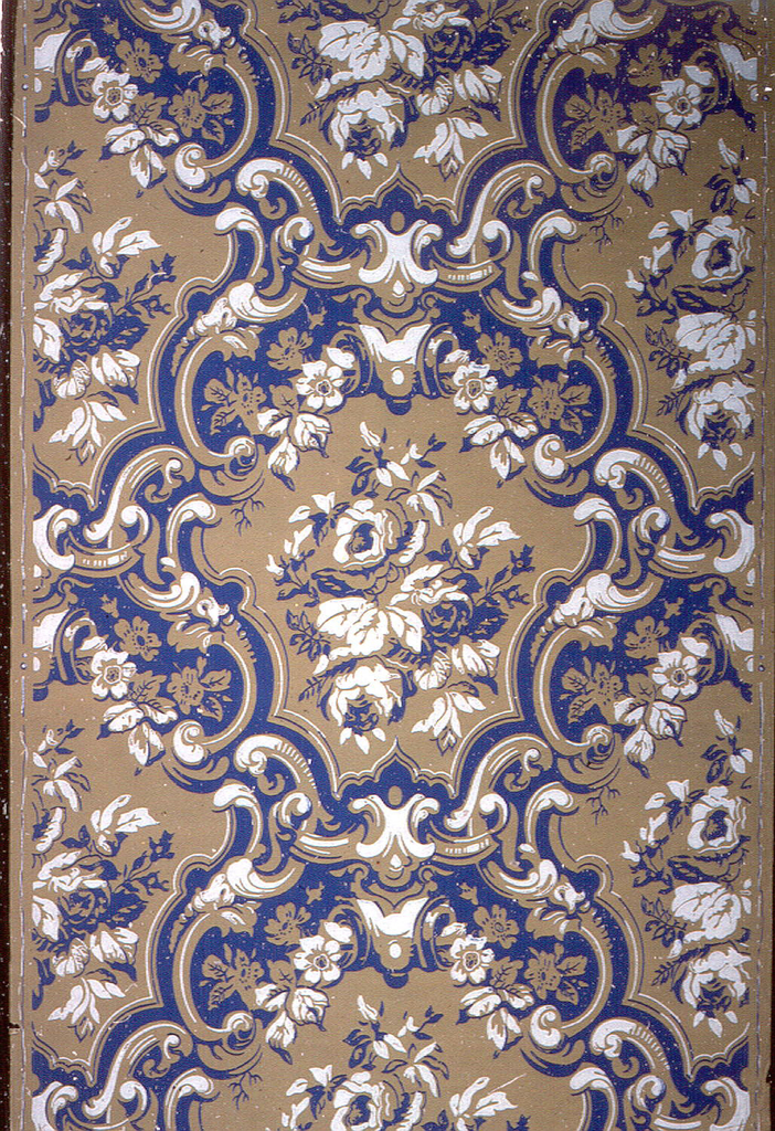 Heavy scrolls framing clusters of roses; royal blue and white on grayish- mustard ground. Repeat: 365 mm.