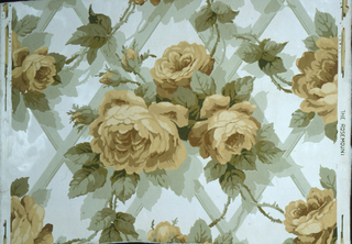 "On white ground with traces of glazing large yellow roses on pale green trellis. Straight repeat, drop match. Printed in left margin: ""The Rosemount""."