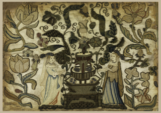 Two ladies flanking a fountain surmounted by a Cupid worked in silks and metal purl.