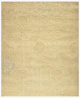Embossed canvas applied to a backing paper, with a stylized design of branches of tudor roses and grape-leaf pattern.