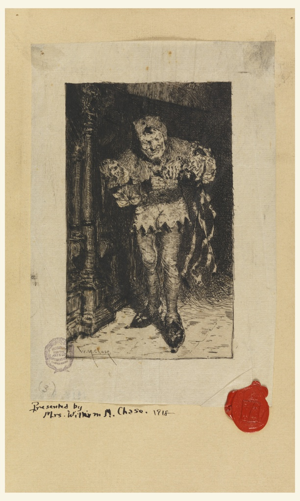 A bearded male figure is dressed as a jester.