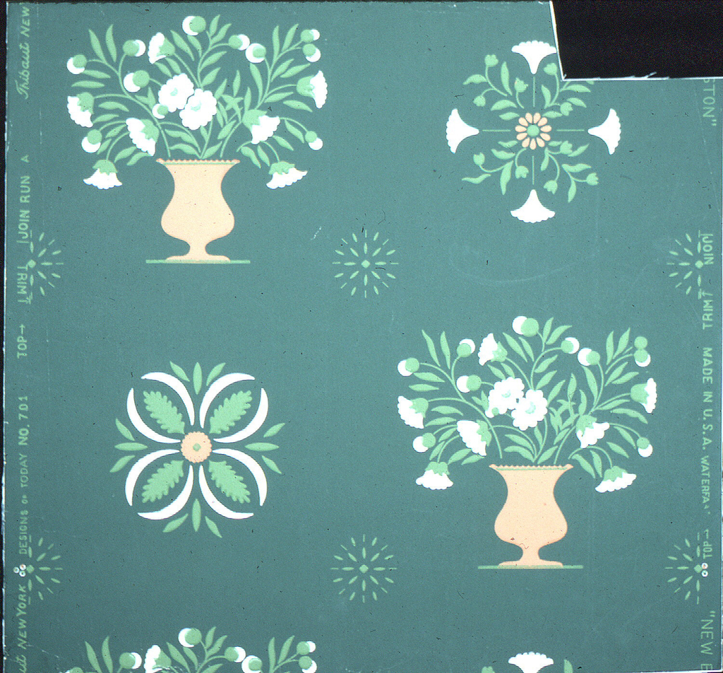 "Diagonal pattern of white flowers in orange vases and circles filled with stylized flowers and leaves. Inspired by a stencil pattern. Printed in margin: ""Thibaut, New York, Design of Today, No. 701, Made in U.S.A., New Boston."""