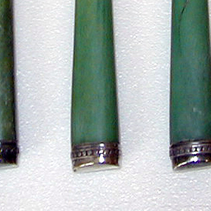 knife (c,d): tapering, stained green ivory handle with beaded silver cap terminal and ferrule and steel blade.