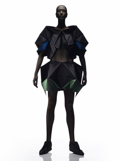 Top with wide neck, front closure and elbow-length sleeves, and short skirt, in pleated black polyester, some areas transfer-printed with green and blue.