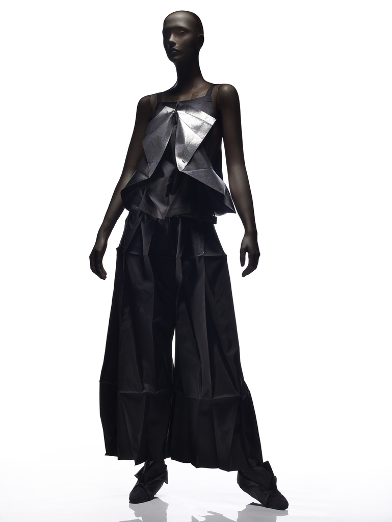 Sleeveless top with narrow shoulder straps and wide-legged pants. Pleated black polyester, some areas transfer printed with silver.
