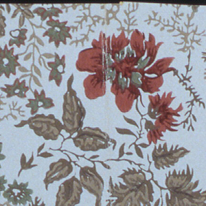 Roses and foliage in an all-over pattern. Printed in red, brown, green and yellow on a beige ground.