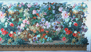 High, thick cluster of flowers and leaves growing from brown soil at bottom. Flowers, in bright colors, are roses, tuberoses, daisies, poppies, morning glories, and others. The base of the pedestal which appears in the decoration fitting above this dado can be seen dimly, on white ground.