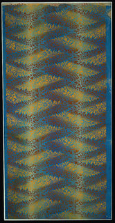 Horizontal cluster of flowers and leaves is arranged in vertical columns, every other cluster being turned around. Horizontally the repeat is dropped so that the flower clusters interlock. Printed on an irise or rainbow background.