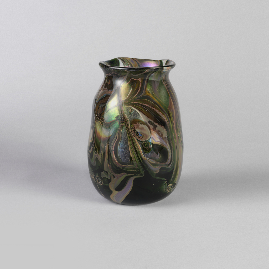 Wide open mouthed vase in dark greens and mauve abstract and swirled shapes.