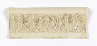 Small pouch with an embroidered flap showing a design of diagonal grape vines.