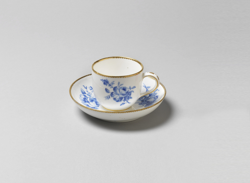Cup and saucer with blue floral decoration. Gilding at rims.