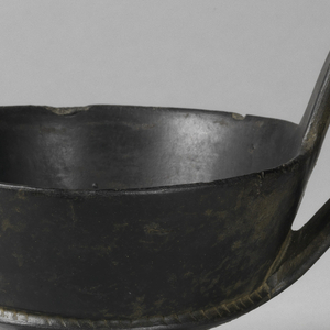 Footed cup with two high looped handles.