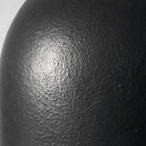 Soft black cylindrical foam body with domed top.