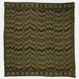 """Bergamo Panel woven to imitate the effect of counted embroidery of the type often called """"flame stitch""""  because of the zig-zag nature of the pattern and the use of color tone and value contrast. The borders are woven seperately. One border has the name of the producer repeatedly woven in, but woven in mirror image."""