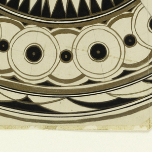 Design for quarter of a plate decorated with circles and points in black and gold; the rest of the plate is in graphite and undecorated.