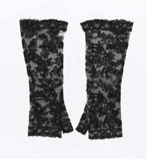 Pair of black mitts showing a flowering vine design.