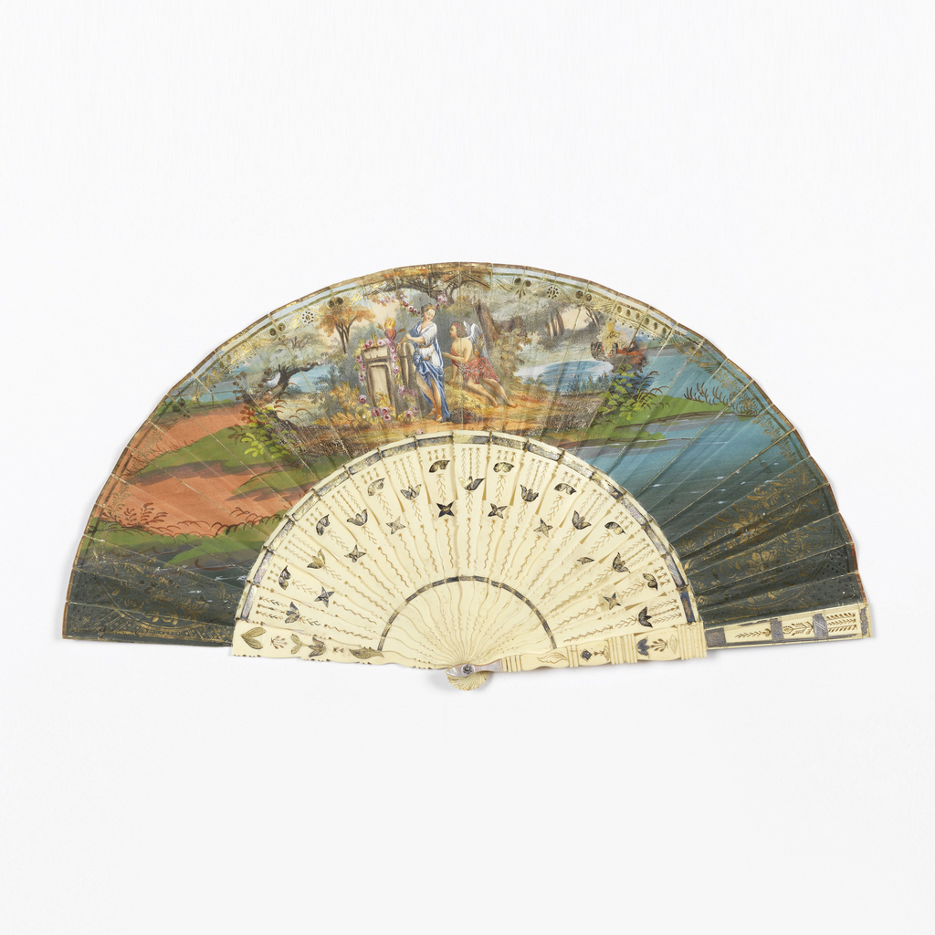 Pleated fan. Gilded paper leaf with hand-colored lithograph. Obverse: Cupid and Psyche (?) in a woodland setting beside altar with flaming hearts pierced by arrows. Reverse: birds and arabesques with central medallion with man and child. Pierced and gilded bone sticks.