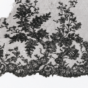 Black Chantilly lace - a/. b/, c/, and d/ show design of branches with flowers and leaves rising from scalloped border.