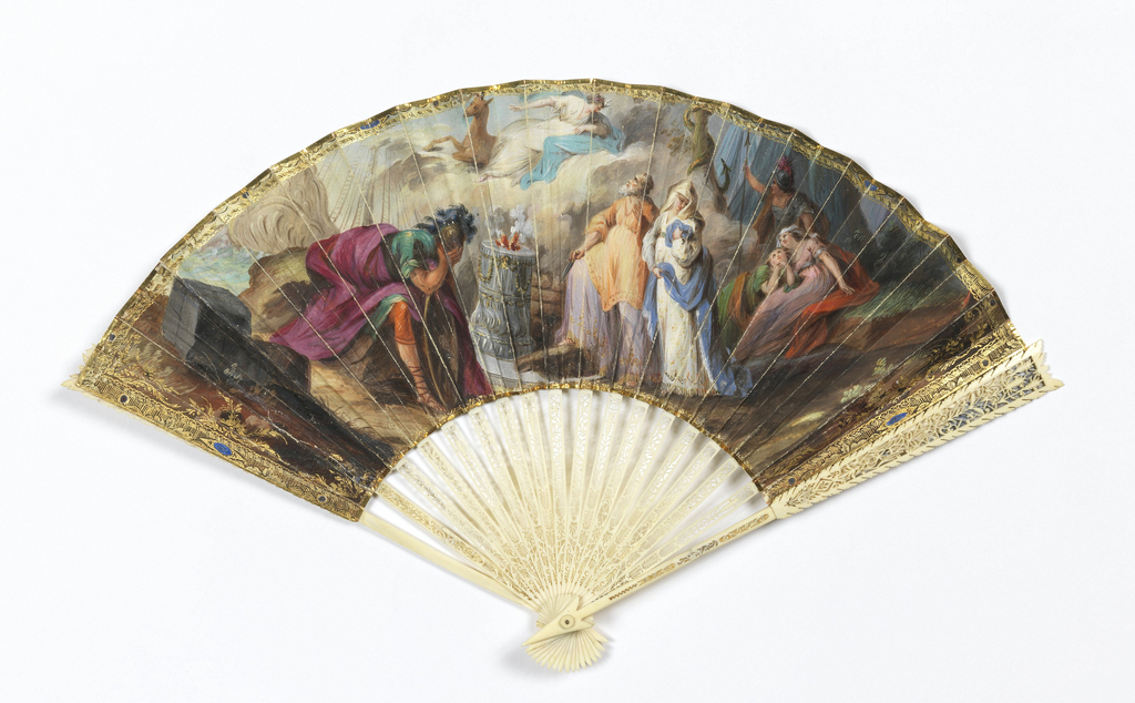 Pleated fan. Gilded parchment leaf painted with gouache. Obverse: classical scene illustrating the sacrifice of Iphigenia showing a sorrowing warrior at left; at center, a sacrificial altar to which the aged priest Colchas leads the weeping Iphigenia, while above in the clouds are Artemis with a deer; at right, a warrior and two female figures, watching the heavenly apparition. Narrow, gilded borders of abstract design interrupted by colored jewel motifs, with additional leaf motifs at ends. Reverse: two figures in a landscape with ruins. Ivory sticks carved à jour with self-contained designs of arrows or tracery combined with a fern motif. Reverse: not carved. Carved arrow-shaped guards, gorge pierced with tiny vine motif and backed with ivory. Reverse of right guard, carved and overlaid with gold foil. Guard proper, edge serrated, decorated with tapering panel of delicate tracery backed by gold foil. Ivory button at rivet.