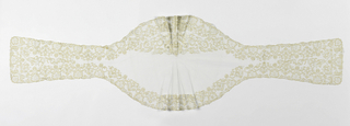 Shaped mantilla of Spanish blonde lace with a stylized floral pattern along the edges.