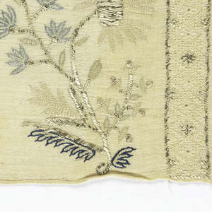 Three towel ends embroidered in an identical pattern of four arching floral stems and bands of openwork.