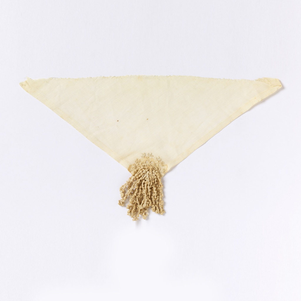 Tassel attached to the corner of a cloth embroidered in a three-lobed leaf pattern.