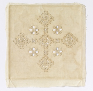 An altar set of four pieces in ivory linen embroidered with ivory linen. Embroidery and cut-work forms a grid of squares with crosses in the centers.