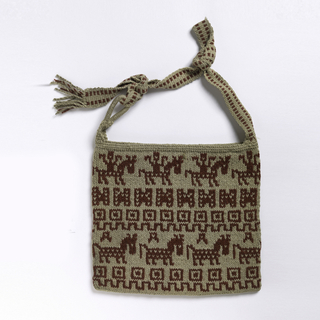 Red and white knitted bag with geometric patterning as well as a stylized design of horseback riders and horses.