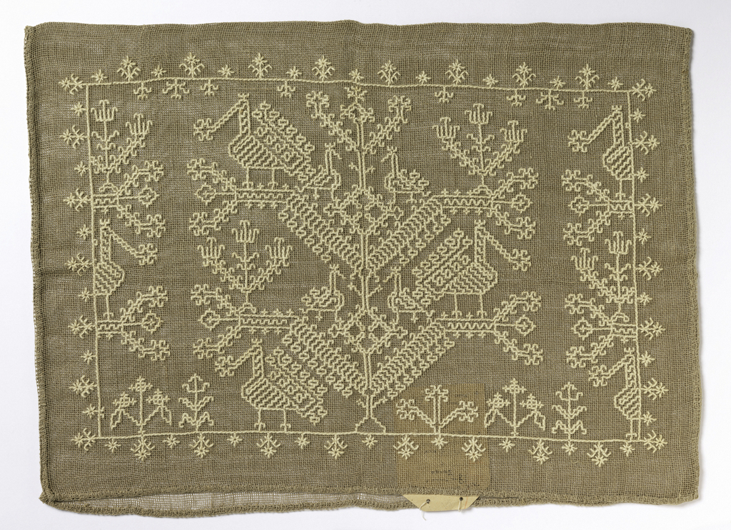 Rectangular case open at one end and constructed of openly woven tan linen.  One side embroidered with a vertically symmetrical pattern of birds on the branches of a plant using heavy white cotton.