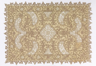 Small cover with horizontal and vertically symmetrical pattern encorporating small plants embroidered in tan linen with large shapes in cut fabric work with needle made fillings (overcast loop stitch). Needle made (overcast loop stitch) outer edging made directly on foundation fabric.  Two coral looped knot-like stitches and herringbone stitches on two parallel rows of buttonhole stitching.