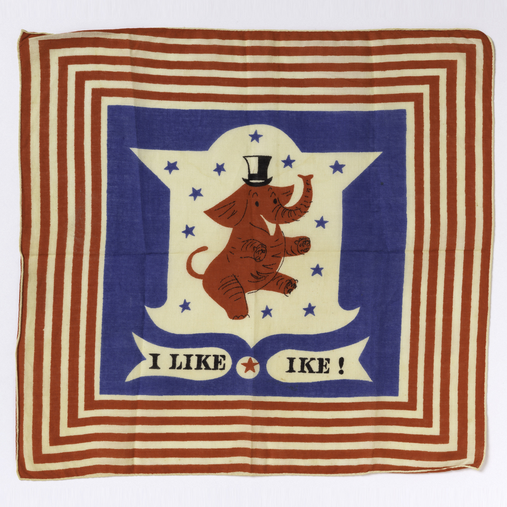 Square handkerchief with a red elephant wearing a black top hat, on a white shield with blue stars, with the slogan I Like Ike below. Blue field with a border of red and white stripes.