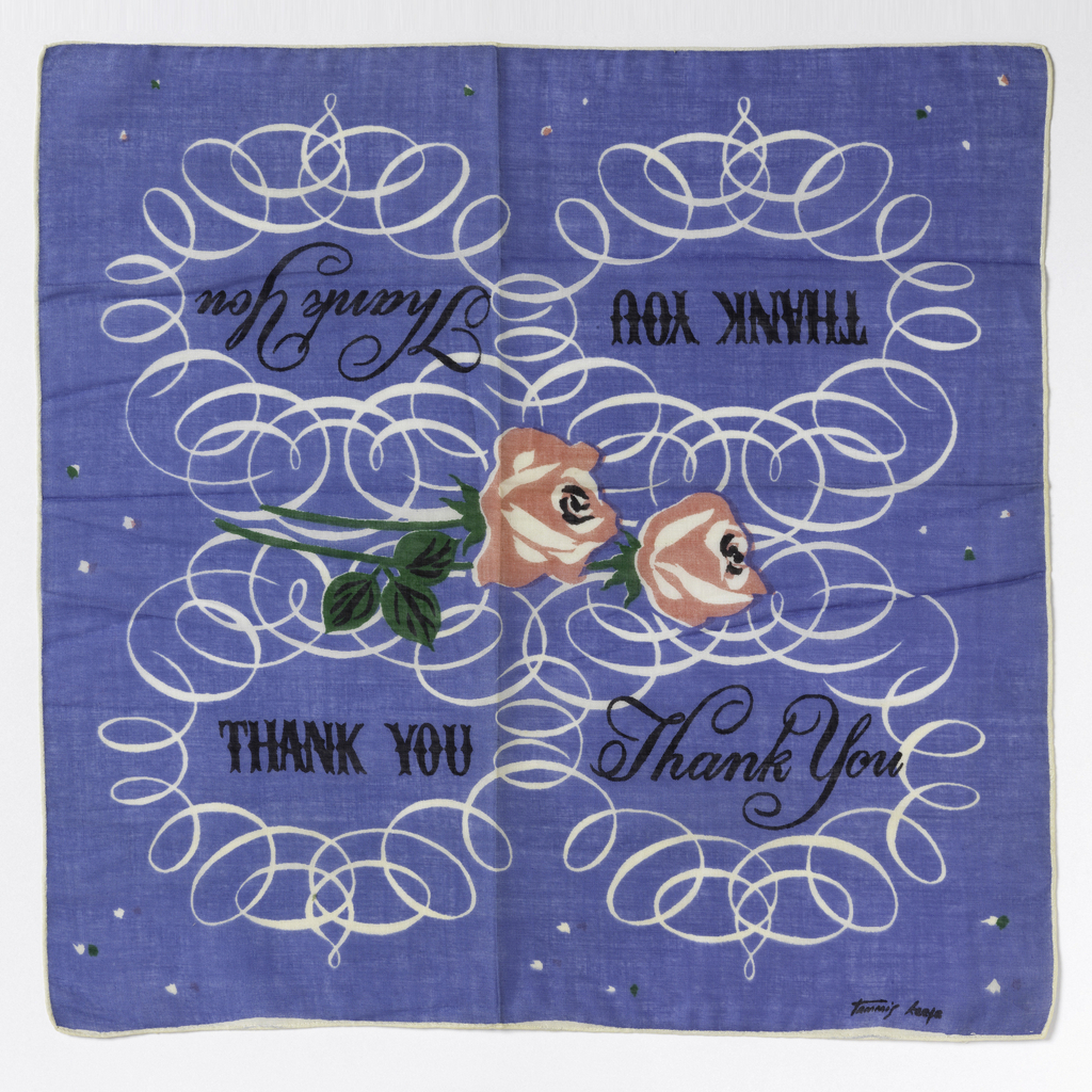 "Small square handkerchief with four ovans of swirling line, each with ""Thank you"" in a different typescript. With two roses in the center. In black, green, pink and white on a blue ground."