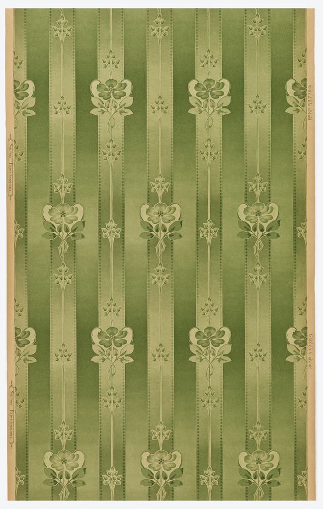 Vertical floral stripe design with each column containing identical floral motifs, large stemmed flower alternating with stemmed floral buds. Every second column is staggered creating a half drop appearance.