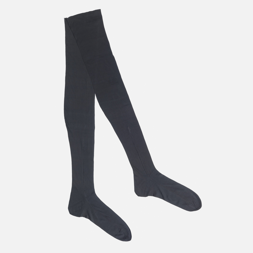 Pair of women's knitted black silk stockings.