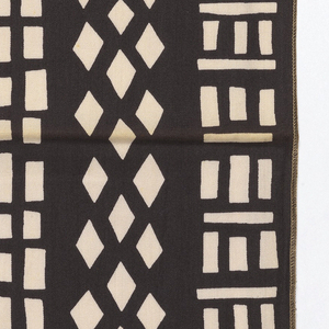 Columns of basic shapes including squares and diamonds, printed in dark grey on off white.  Serged on all 4 sides.
