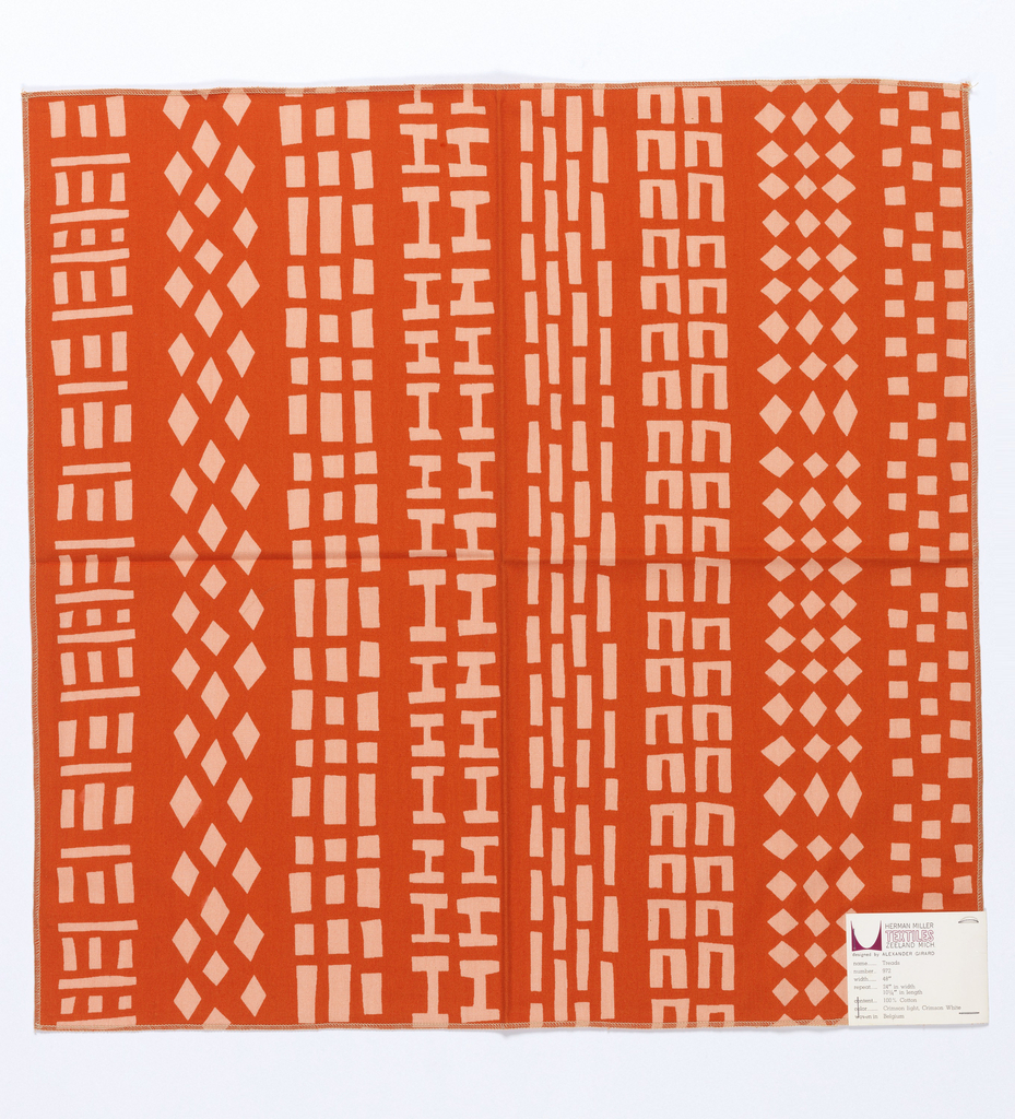 Columns of basic shapes including squares and diamonds, printed in orange/red on pink. Serged on all 4 sides.