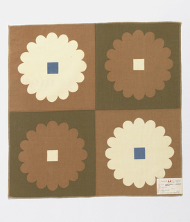 Printed sample with a checkerboard of alternating squares: tan with a white flower and a square blue center, or green with a tan flower and a square white center.