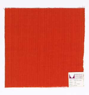 Plain-woven cotton in red-orange. Slight variation in the color of the warp threads gives a subtle stripe effect.