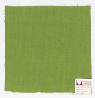 Plain-woven cotton in light green. Slight variations in the color of the warp threads give a subtle stripe effect.