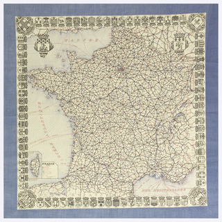 Printed handkerchief with a detailed road map of France, with an inset of Corsica. With the coats of arms of the prefectures forming an inner border. Printed in black, blue and red on a white ground, blue border.
