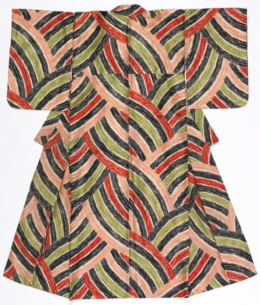 Woman's lined silk kimono with an overall abstract design of sweeping arcs of color with an uneven, hand-drawn feel. In black, green, red-orange, pink and white.
