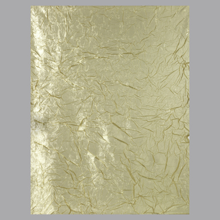 Legth of sheer golden-yellow semi-transparent fabric with irregular creases texturing the surface.