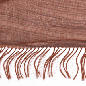 In this triple-weave construction, one set of warps is eliminated and the blue wefts are allowed to float freely between two layers of bright red sheer woven cloth.