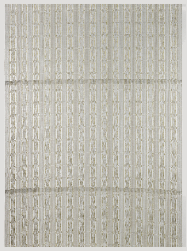 Vertical stripes of shiny white and gold viscose fibers held in a stainless steel mesh, alternating bands of warp conventionally bound with bands where the warp is permitted to drift.